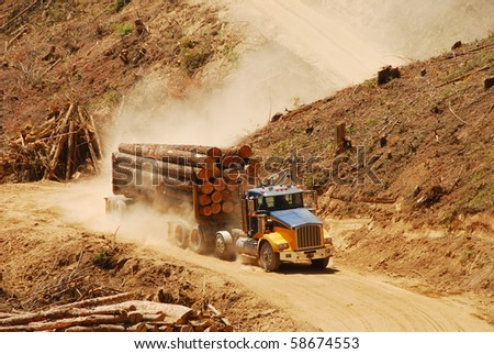 "A loaded log truck  on a logging operation or ""side"" in the foothills of the Cascade Mountains in southern Oregon"
