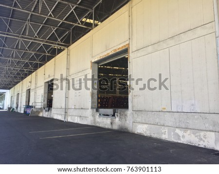 A loading dock or loading bay is an area of a building where goods vehicles are loaded and unloaded. They are commonly found on commercial and industrial buildings, and warehouses in particular. #763901113