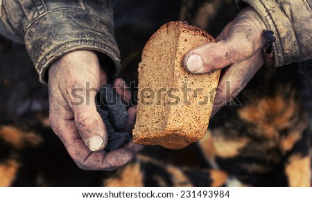 A loaf of bread in an old mans hands Сток-фото ©