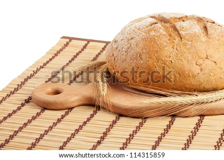 A loaf of bread on a board isolated on white background