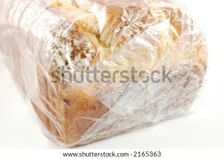 A loaf of bread wrapped in cellophane on an isolated white background