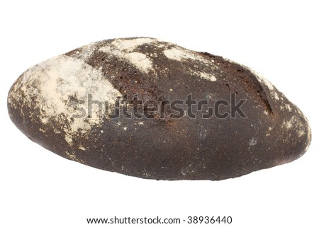 A loaf of dark Russian rye artisan bread isolated on a white background
