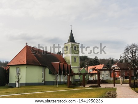 A local attraction: The church of the Heart of Jesus, modern nave and old belfry, Heviz, Egregy village, Hungary Сток-фото ©