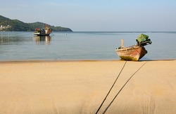 A local fishing boat on the beach., Traditional fishing boats on the coast at dawn To wait for the night fishing.
