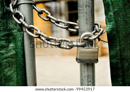 a lock and chain on gate
