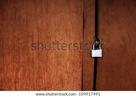 A lock on the old wood wall