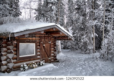 a log cabin frosted over in sub ...
