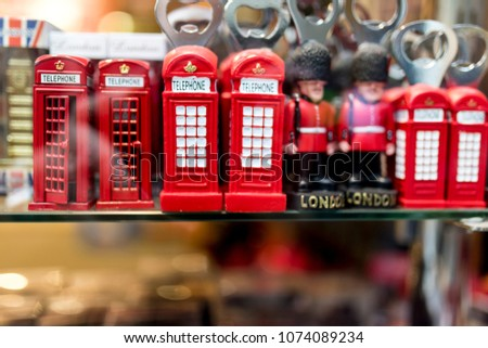 A London souvenir shop displaying British souvenirs including classic British red telephone boxes and beefeater and London Tower Guards bottle openers in the UK