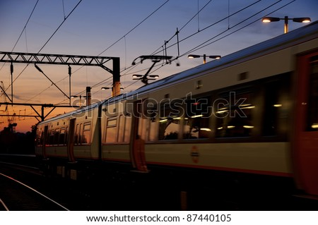 A London Underground metro train riding at sunset