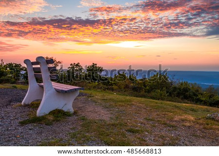 a lone bench looks over the...