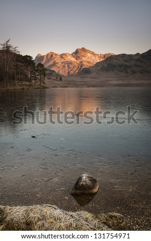 A lone rock stands defiant on the shore of Wast Water