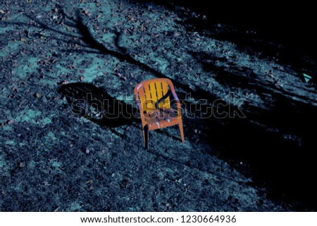 A lonely chair in a lonely backyard