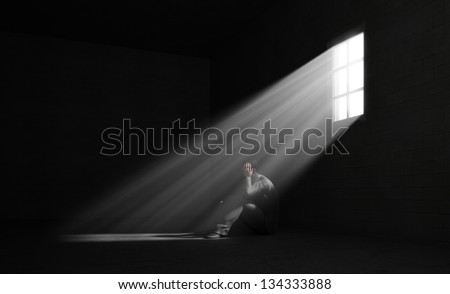 A lonely man in a dark room