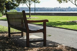 a lonely park bench in sydney harbour park australia