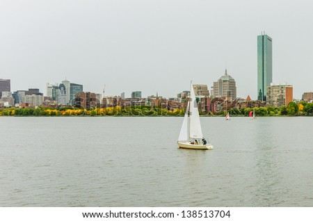 A Lonely Sailing Boat and Boston Skyline on a Rainy Day