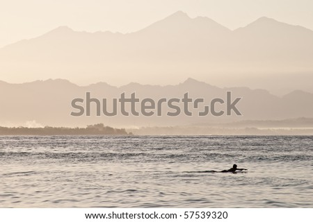 A lonely surfer out at sea in Gili Trawangan, Indonesia