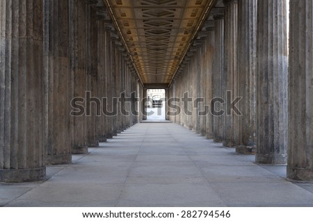 A long corridor between many columns in a historical building in berlin