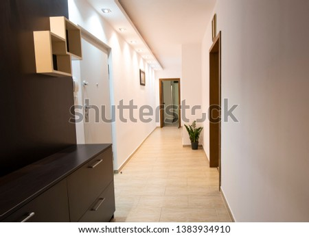 A long corridor with lights in an apartment. Entrance to the apartment