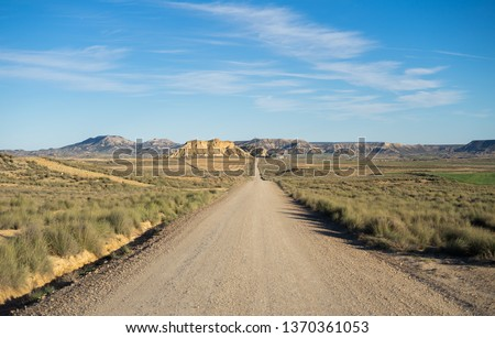 A long desertic road in the middle of nowhere