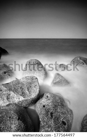 A Long Exposure At Beach With Repeating Rocks Black And White