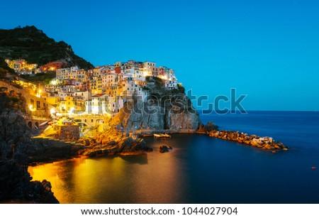 A long exposure night photo of the beautiful houses of Manarola,Italy,Cinque Terre National Park,Liguria,Europe