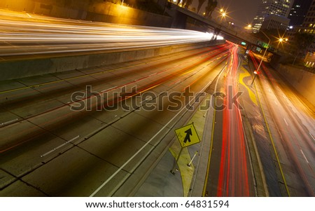 A long exposure of a freeway at night in the city.
