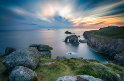 A long exposure of a sunset over Lands End in Cornwall, looking out towards the Long Ships lighthouse