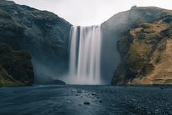 A long exposure photo of Icelandic waterfall called Skogafoss during the COVID outbreak without people