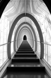 A long futuristic corridor, arch shaped, bright, with stairs leading to the unknown, the end of the path is black. Great perspective and futuristic aspect.