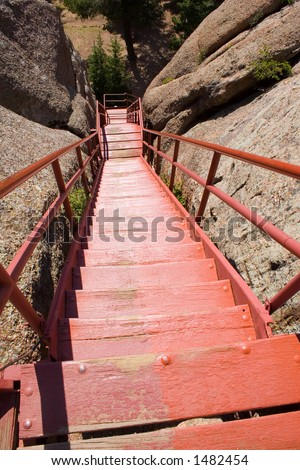 A long line of red steps lead the way down from the fire watchtower on Devil's Head in central Colorado