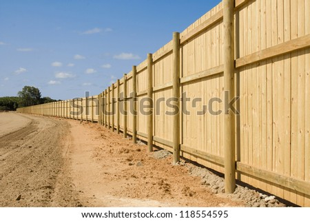a long new fence on new property development - stock photo