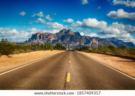 A long remote road leading to the base of famous Superstition Mountain in Arizona shows the beauty of this desert landscape. Photo stock ©