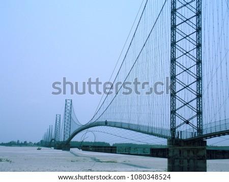a long suspension bridge  #1080348524