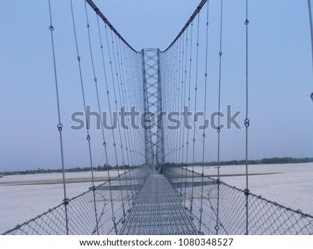 a long suspension bridge  #1080348527