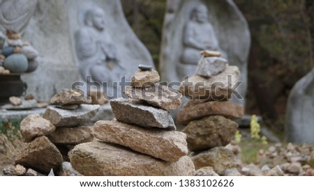 A long time ago in Korea, people wanted to make their wish come true by stacking rocks. These stone stacks are common in old temples and mountain peaks. #1383102626