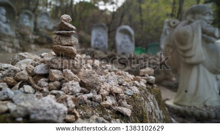 A long time ago in Korea, people wanted to make their wish come true by stacking rocks. These stone stacks are common in old temples and mountain peaks. #1383102629