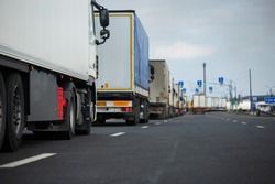 a long traffic jam of many trucks at the border , a long wait for customs checks between States due to the coronavirus epidemic, increased sanitary inspection of cargo transport