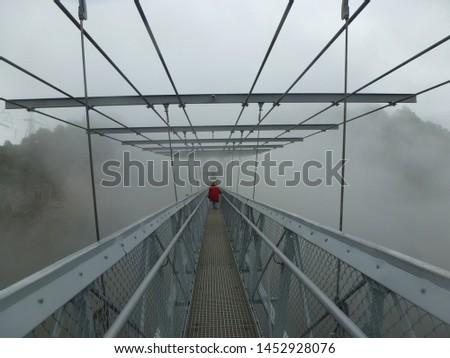 A long way on the skybridge in a fog. #1452928076
