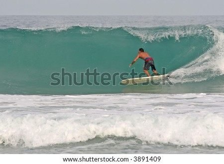 A longboarder rides a clean hollow wave