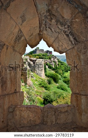 A look at a ruined fortress walls trough the fort window