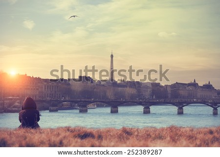 A look at the Paris to Seine river and Eiffel tower with lonesome girl. Conceptual mosaic.