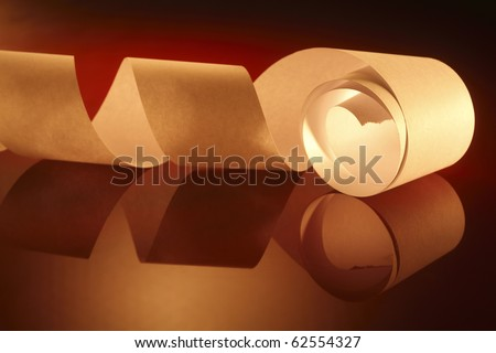 A loose white roll of receipt paper with lighting effect colour background