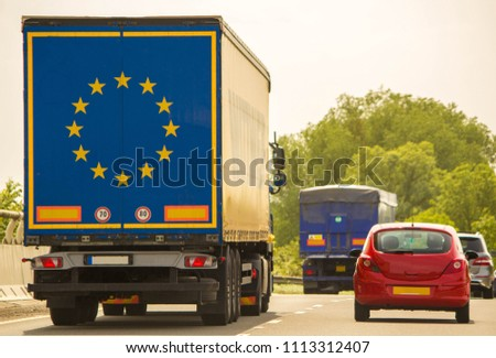 A lorry traveling along a motorway in the United Kingdom.