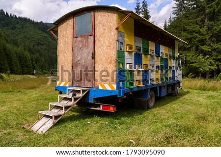 Photo of  A lorry with bee hives in the mountains