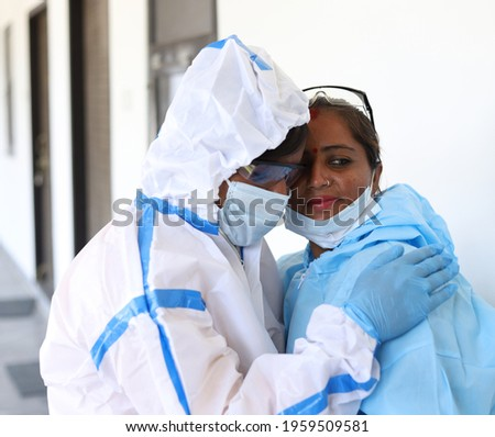 A loseup shot of two Indian doctors with medical uniform comforting each other on a white background Stockfoto ©