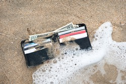 A lost wallet in the surf zone at the beach.