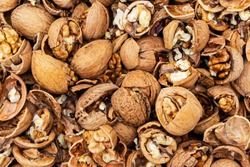 A lot Crushed walnuts with skin, background, texture