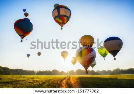 A Lot Of Balloons Start They Flight Over Field And Forest