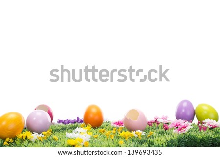 A lot of beautiful Easter eggs on a flowering meadow