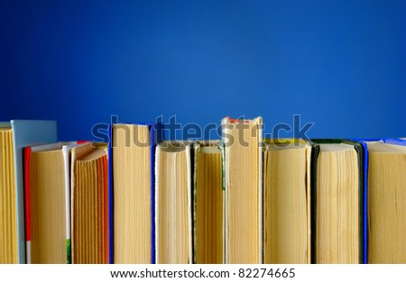a lot of books on a blue background